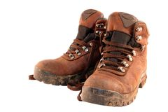 Hiking Boots #2. A pair of worn, muddy brown hiking boots, isolated on white stock photos