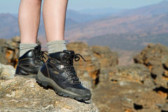 Hiking boots. A photo of a female hiker showing only the boots and part of her legs Stock Photography