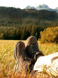 Hiking boots. Of relaxing man in The High Tatras in Slovakia stock photo