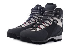 Hiking boots. A pair of hiking boots with soft shadow on white background Stock Images