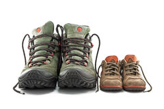 Hiking boots adult and children's shoes. Isolated on white background Stock Photos