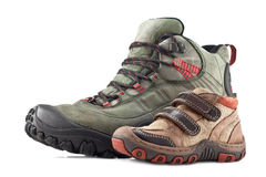 Hiking boots adult and children's shoes. On white background Royalty Free Stock Photos