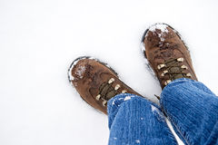 Hiking boots against snow Royalty Free Stock Photography