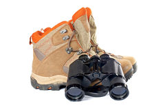 Hiking boots and binoculars Stock Photography