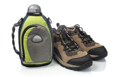 Hiking boots and canteen Stock Image