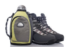 Hiking boots and canteen Royalty Free Stock Photography