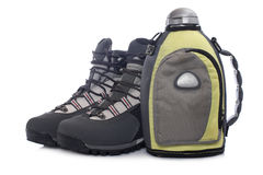 Hiking boots and canteen Royalty Free Stock Images
