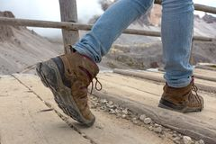 Hiking boots close-up. Tourist walking on the trail. Italy Royalty Free Stock Images