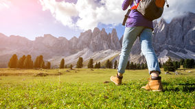 Hiking boots. Close-up. tourist walking at the Puez Odle. Italy stock photography