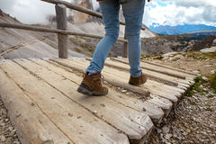 Hiking boots. Close-up. tourist walking on the trail. Dolomites, Italy Royalty Free Stock Photos