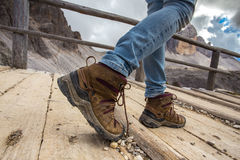 Hiking boots. Close-up. tourist walking on the trail. Italy Stock Photography