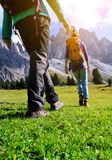 Hiking boots. Close-up. Two girl tourist walking at the Puez Odle. Italy Royalty Free Stock Image