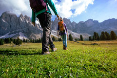 Hiking boots. Close-up. Two girl tourist walking at the Puez Odle. Italy Royalty Free Stock Photo