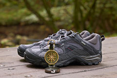 Hiking boots and compass Royalty Free Stock Photos
