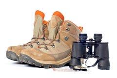 Hiking boots, compass and binoculars stock image