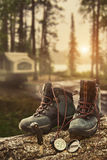 Hiking boots with compass at campsite stock images