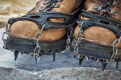 Hiking boots with crampons Royalty Free Stock Images