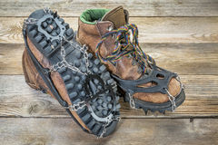 Hiking boots with crampons Stock Photo