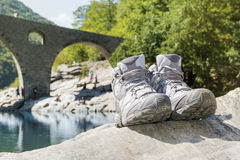 Hiking boots on a Devil's Bridge over Arda River Royalty Free Stock Photos