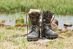 Hiking boots. Dirty hiking (military) boots in the photo Stock Photo