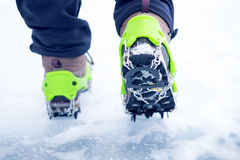 Hiking boots with equipment for ice. Snow like a background and sun. Sun is shining. Moutains and travel. Hiking boots with equipment for ice. Snow like a Royalty Free Stock Photo