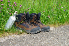 Hiking boots in front of a summer meadow Stock Images