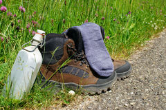 Hiking boots in front of a summer meadow Royalty Free Stock Photo