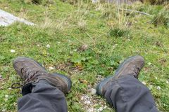 Hiking boots on green meadow, Austria royalty free stock photos