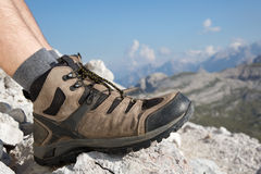 Hiking boots of a hiker in the mountains Stock Image