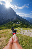 Hiking boots. Hiker resting in mountains on a beautiful sunny day Stock Photos