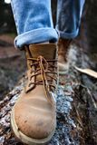 Hiking boots. Close-up. girl tourist steps on a log Stock Images