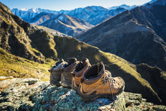 Hiking boots lying on top of the mountain Stock Images
