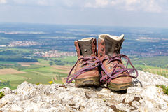Hiking boots on a mountain royalty free stock images
