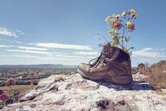 Hiking boots on a mountain trail royalty free stock photography