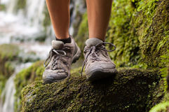 Hiking boots in an outdoor action. Waterproof hiking boots with a stream in a background Stock Photo