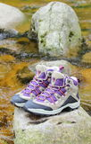 Hiking boots over a mountain stream Royalty Free Stock Image
