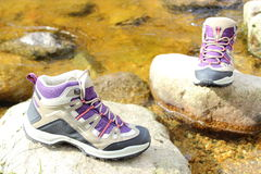 Hiking boots over a mountain stream Stock Photo