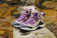 Hiking boots over a mountain stream Royalty Free Stock Photo