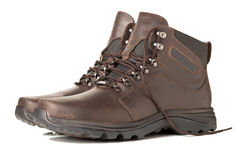 Hiking Boots. A Pair of Brown Hiking Boots Isolated on a White Background Royalty Free Stock Image