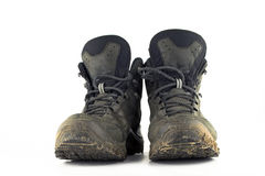Hiking boots shoes. A pair of dirty hiking boots / shoes isolated on white background Stock Photography