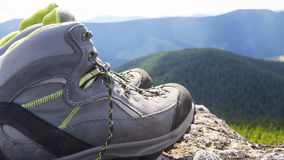 Hiking boots. Pair of mountain hiking boots on the peak in nature Stock Image