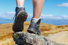 Hiking boots on the rock Royalty Free Stock Photography