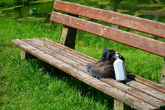 Hiking boots on a seat bench Royalty Free Stock Image