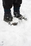 Hiking boots in snow Royalty Free Stock Photo