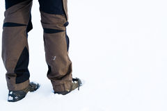 Hiking boots in the snow Stock Images
