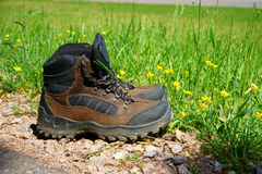 Hiking boots stand on the wayside Royalty Free Stock Photo