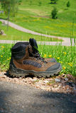 Hiking boots stand on the wayside Stock Photography