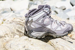 Hiking boots Standing on the stones Royalty Free Stock Photos