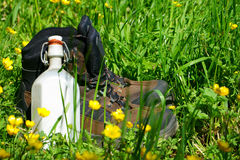 Hiking boots on a summer meadow Stock Photography