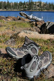 Hiking boots in the sun. A pair of hiking boots drying in the sun by a lake in the wilderness Stock Photo